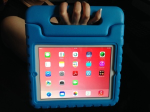 iPad in blue padded case with handle.